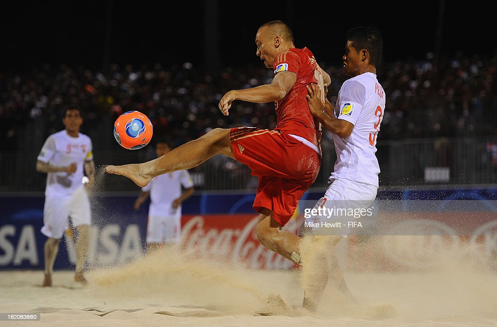 Marama Amau of Tahiti challenges Egor Eremeev of Russia during the FIFA Beach Soccer World Cup Tahiti 2013 Semi Final match between Russia and Tahiti at the Tahua To'ata Stadium on September 27, 2013 in Papeete, French Polynesia.