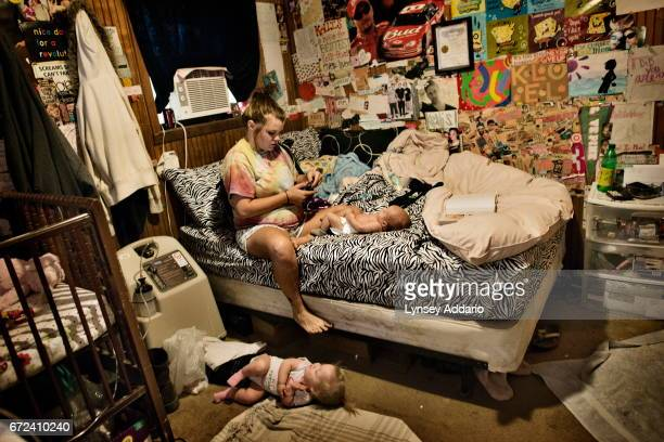 Maranda Corely sits in her bedroom with her three childrenin their bedroom in Ellisville Mississippi June 2 2012 Maranda got pregnant for the first...