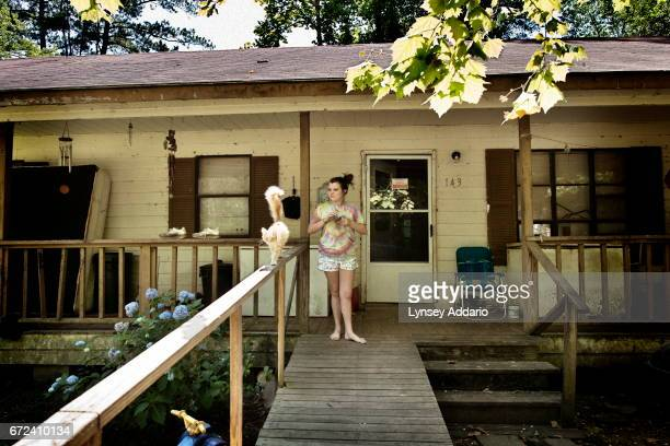 Maranda Corely stands outside of her home in Ellisville Mississippi June 2 2012 Maranda got pregnant for the first time when she was 15 had twins...