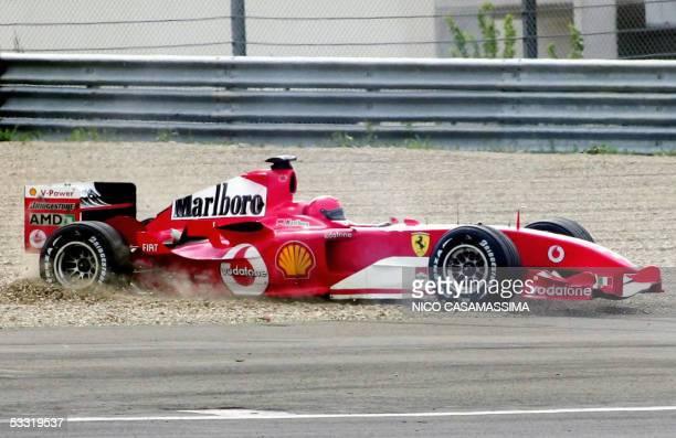 Italian moto GP rider Valentino Rossi steers into the gravel the F1 Ferrari 2004 on Ferrari's racetrack in Maranello 03 August 2005 The famous moto...