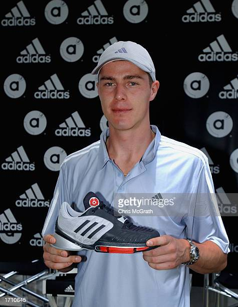 Marat Saffin models his new shoes at the launch of his new Adidas shoe line on the second day of the Adidas International tennis tournament at the...
