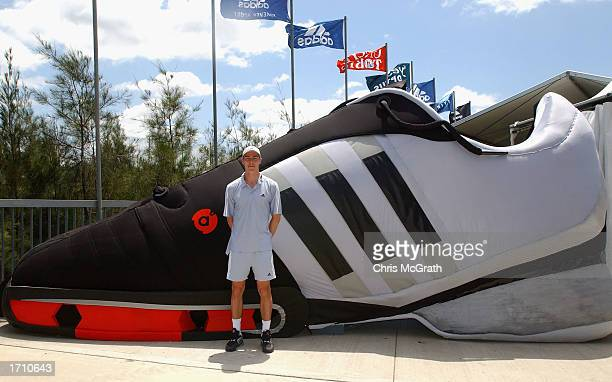 Marat Saffin stands in front of a giant replica shoe at the launch of his new Adidas shoe line on the second day of the Adidas International tennis...