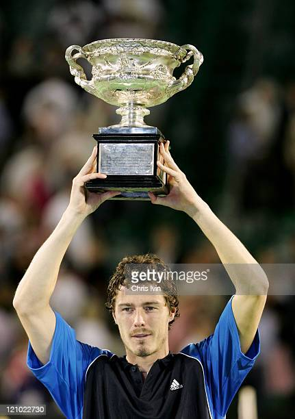 Marat Safin holds winners trophy Marat Safin beats Lleyton Hewitt 16 63 64 64 in the Men's Singles Final at the Rod Laver Arena Melbourne Australia