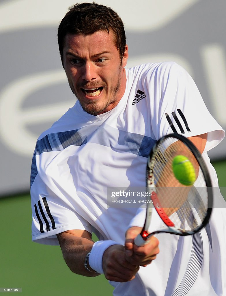 Marat Safin of Russia hits a backhand re