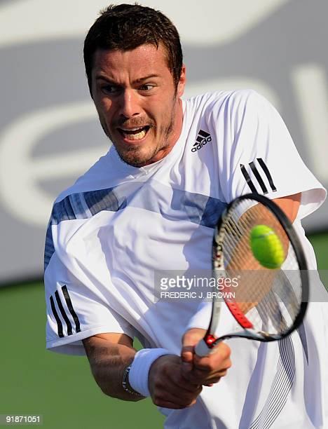 Marat Safin of Russia hits a backhand return against Tomas Berdych of Czech Republic during their second round match at the ATP Masters tennis...