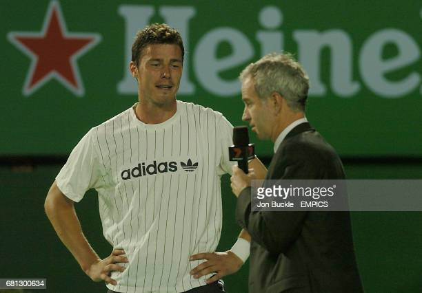 Marat Safin of Russia is interviewed by tennis legend John McEnroe after defeating Andy Roddick of USA