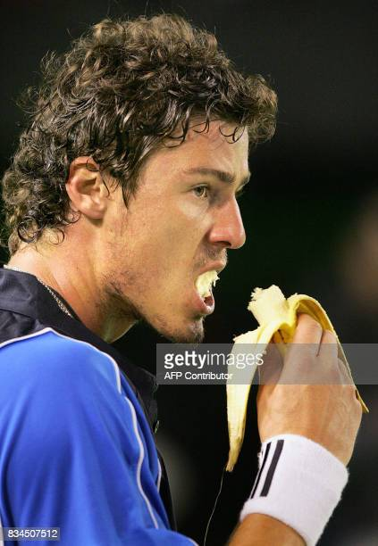 Marat Safin of Russia munches on a banana during a change over while playing against Lleyton Hewitt of Australia in the men's final at the 2005...