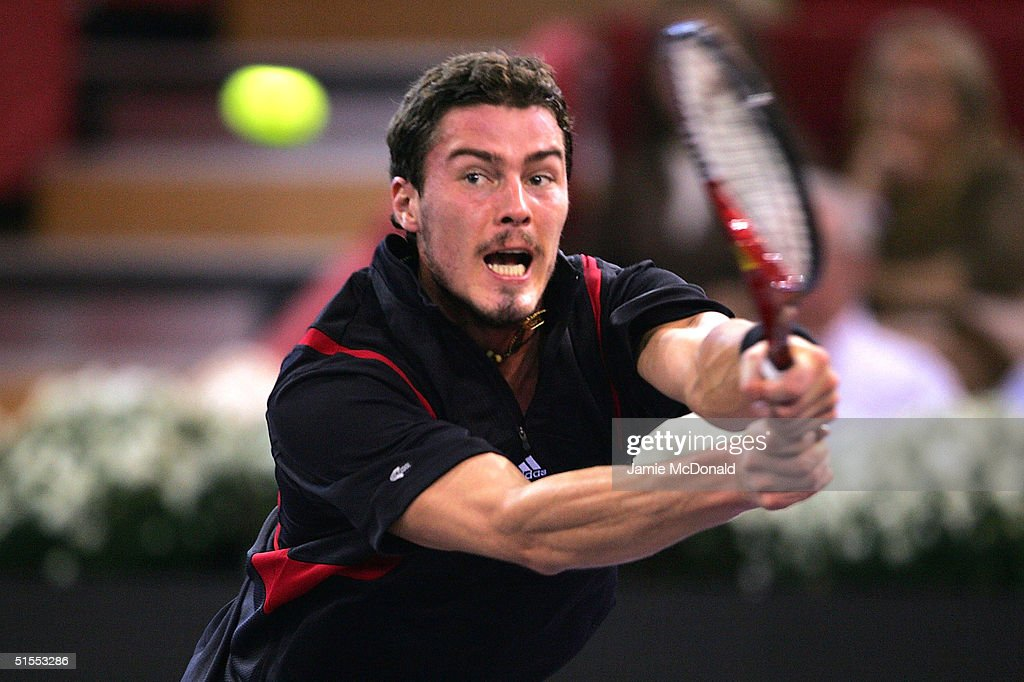 Marat Safin of Russia plays a backhand during his semi final match against Andre Agassi of USA during the ATP Madrid Masters at the Nuevo Rockodromo on October 23, 2004 in Madrid, Spain.