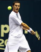 Marat Safin of Russia plays a backhand in his match against Philipp Petzschner of Germany during day four of the 2009 Thailand Open at Impact Arena...