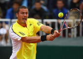 Marat Safin of Russia plays a backhand in his match against Tommy Robredo of Spain during day two of the Foro Italico Tennis Masters on April 28 2009...