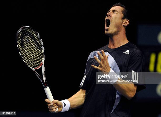 Marat Safin of Russia reacts to a point during his second round of ATP Thailand Open tennis match Swiss player Macro Chiudinelli in Bangkok on...