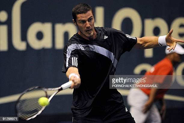 Marat Safin of Russia returns to Swiss player Macro Chiudinelli during their second round ATP Thailand Open tennis match in Bangkok on October 1 2009...