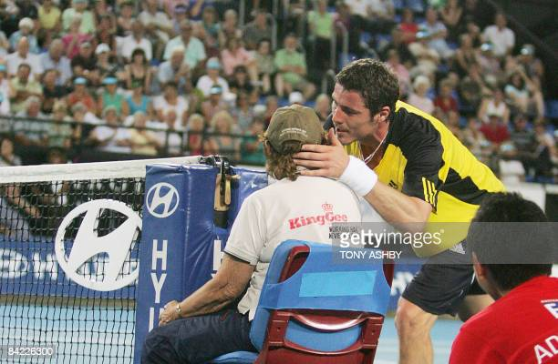 Marat Safin of Russia rushes to kiss a net judge after he thought she had been hit by his return to Dominik Hrbaty of the Slovak Republic during...