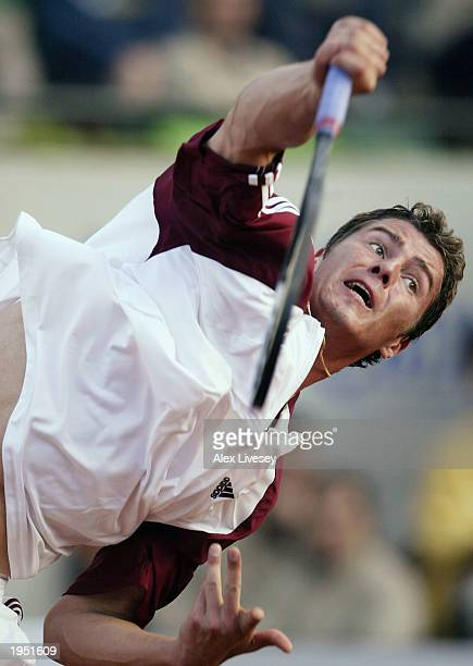 Marat Safin of Russia serves during his QuarterFinal match against Gaston Gaudio of Argentina in the ATP Seat Open held at the Real Club de Tenis in...