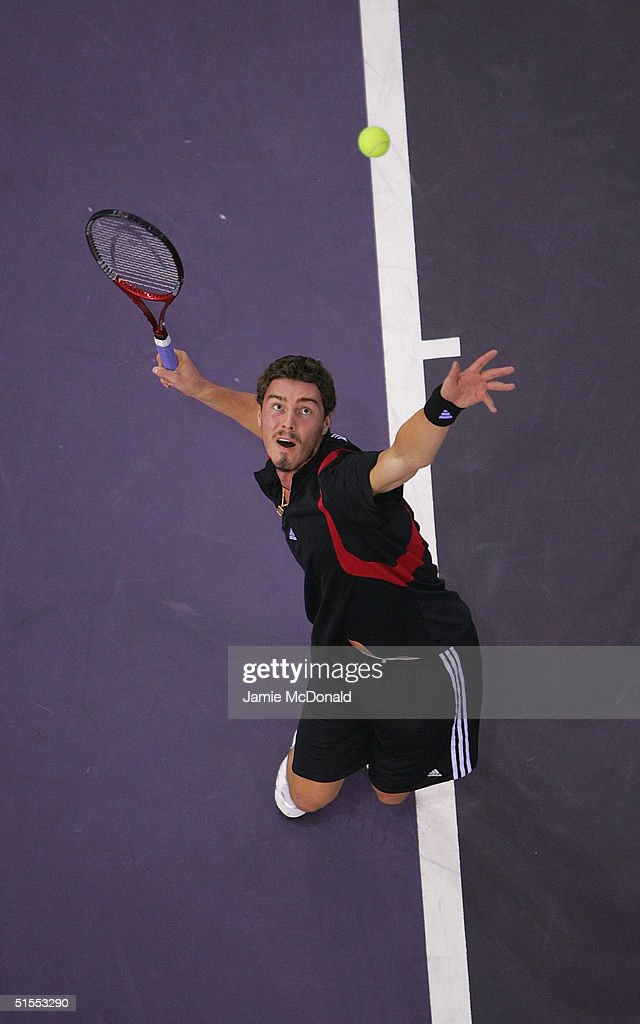 Marat Safin of Russia serves in his semi final match against Andre Agassi of USA during the ATP Madrid Masters at the Nuevo Rockodromo on October 23, 2004 in Madrid, Spain.