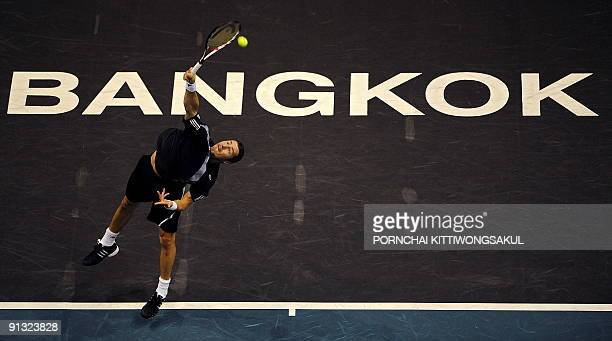 Marat Safin of Russia serves to Swiss player Macro Chiudinelli during their second round ATP Thailand Open tennis match in Bangkok on October 1 2009...