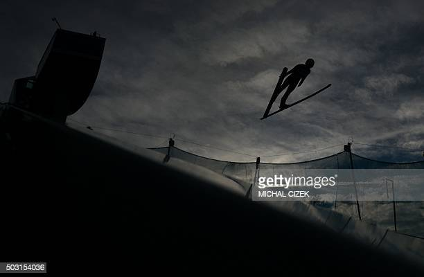 TOPSHOT Marat Zhaparov of Kazahstan competes during the qualification of the Four Hills competition of the FIS Ski Jumping World Cup in Innsbruck on...