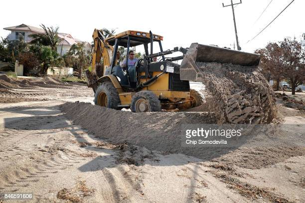 Marathon Fire and Rescue uses an earth mover to shovel sand dumped by Hurricane Irma's storm surge on the road in front of Sombrero Beach September...