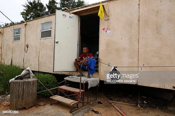 Marathon runner Ageze Guadie a 27yearold Israeli of Ethiopian origin sits at the entrance of the trailer where he lives in Netanya near Tel Aviv on...
