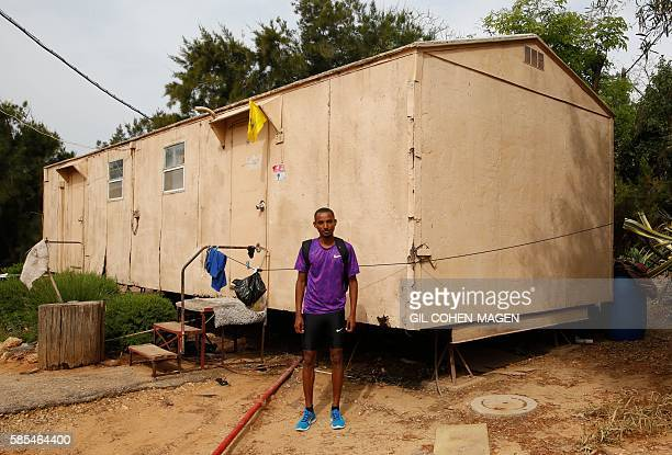 Marathon runner Ageze Guadie a 27yearold Israeli of Ethiopian origin poses for a photo in front of the trailer where he lives in Netanya near Tel...
