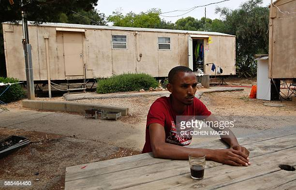 Marathon runner Ageze Guadie a 27yearold Israeli of Ethiopian origin speaks with a friend at the trailer park where he lives in Netanya near Tel Aviv...