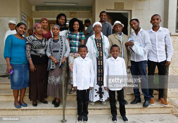 Marathon runner Ageze Guadie a 27yearold Israeli of Ethiopian origin poses for a family photo following the circumcision of his nephew at a synagogue...