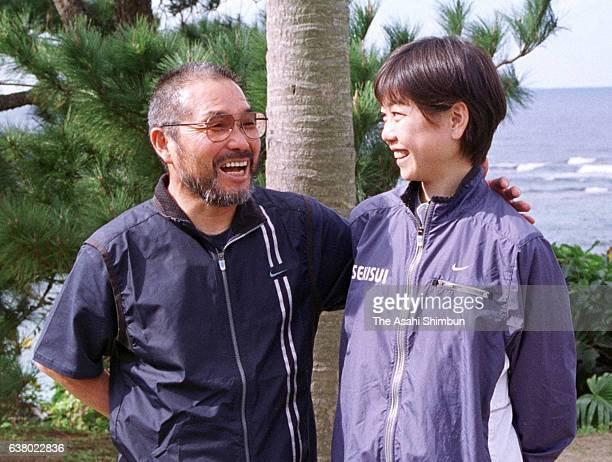 Marathon runner Naoko Takahashi and her coach Yoshio Koide speak to medai during a training session on February 10 2000 in Tokunoshima Kagoshima Japan