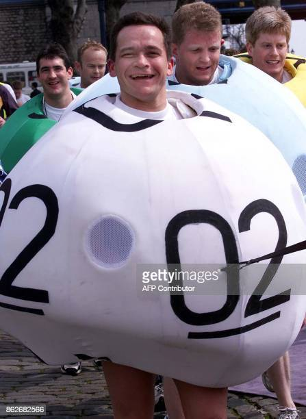 Marathon runners dressed up as lottery balls take part in the London Marathon 22 April 2001 Over 30000 runners are expected to finish the 2001 London...