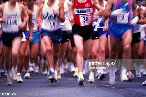 Marathon runners in action, low angle view