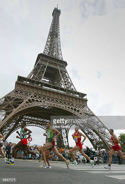 Marathon runners pass the Eiffel Tower during the IAAF World Athletics Championships on August 30 2003 in Paris France