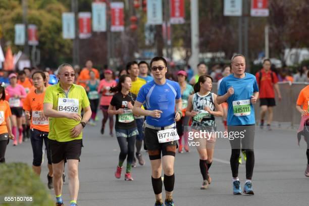 Marathon runners run along the Yangtze River at Nan Bin Road on March 19 2017 in Chongqing China Chongqing International Marathon takes place on...