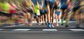 Marathon running race people feet on city road,abstract