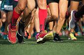 Marathon running race, people feet on the lawn