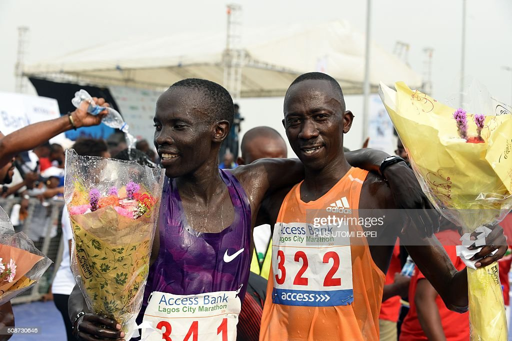 Marathon winner Kenyan Abraham Kipton (L) hugs compatriot and runner-up Hosea Kiptemboi at the end of the first Lagos City Marathon, on February 6, 2016 in Lagos. / AFP / PIUS UTOMI EKPEI