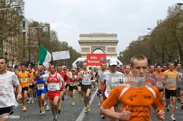 Marathoners running along Champs-Elysees during 2008 Paris Marathon.