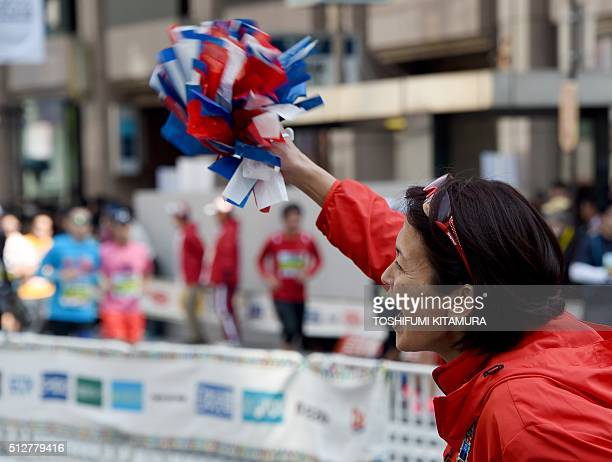 Marathon's Barcelona Olympics silver medalist and Atlanta Olympics bronze medalist Yuko Arimori of Japan shouts to competitors as they run through...