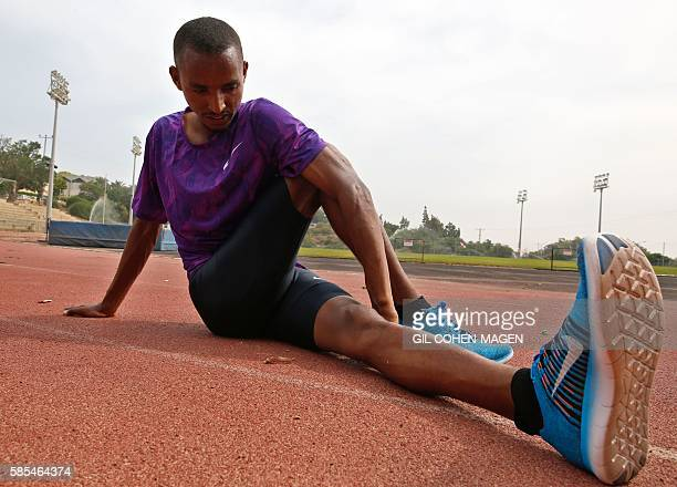 Maraton runner Ageze Guadie a 27yearold Israeli of Ethiopian origin stretches as he trains at the Wingate Institute in Netanya near Tel Aviv on May...