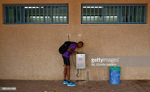 Maraton runner Ageze Guadie a 27yearold Israeli of Ethiopian origin drinks water as he trains at the Wingate Institute in Netanya near Tel Aviv on...
