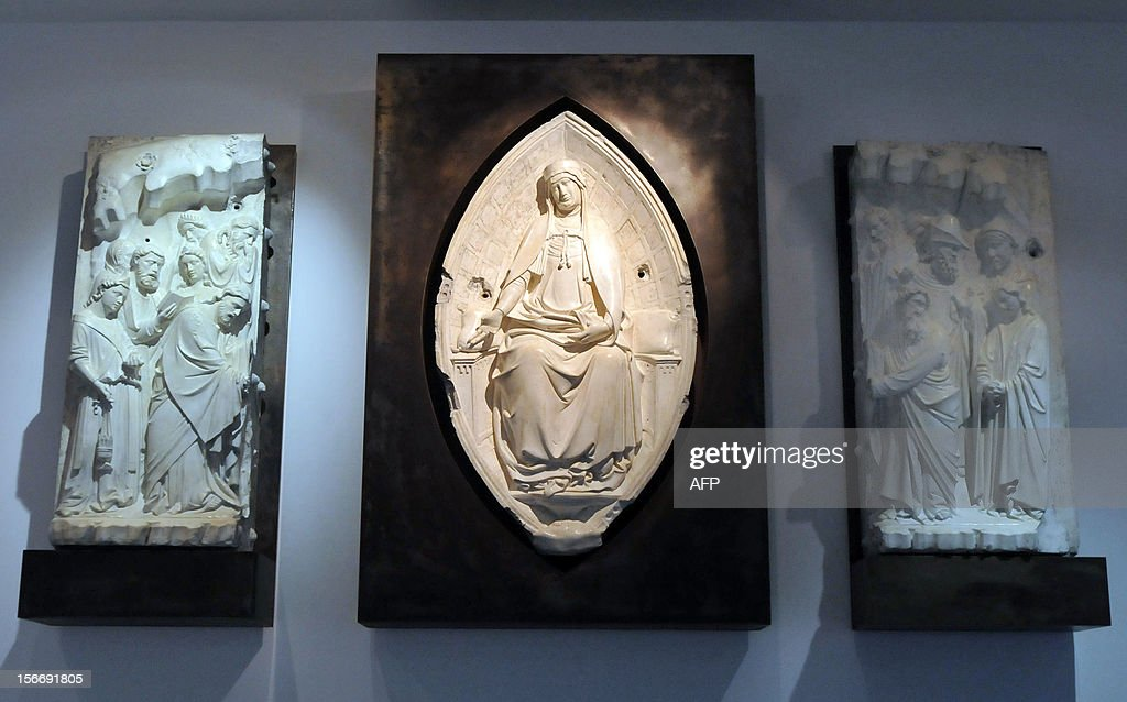 A marble art pieces donated by the Metropolitan Museum of Art, made by artist Andrea Orcagna and named 'Assumption of the Virgin', the Orsanmichele Church in Florence, Italy, is on display at the National Museum in Taipei on November 19, 2012. The Metropolitan Museum of Art selected the Taiwan Museum or Educational Institutions to gift the art collection of 100 medieval plaster statues. AFP PHOTO / Mandy CHENG