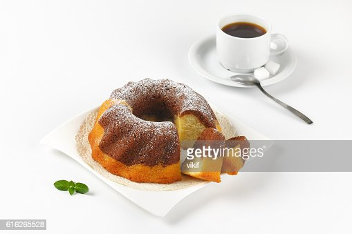 marble bundt cake and cup of coffee : Stock Photo