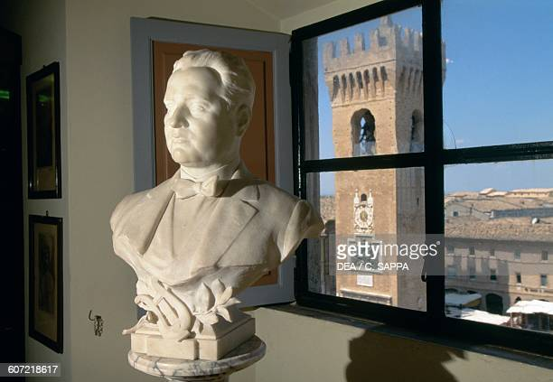 Marble bust of Beniamino Gigli with the Civic tower in the background Recanati Marche Italy