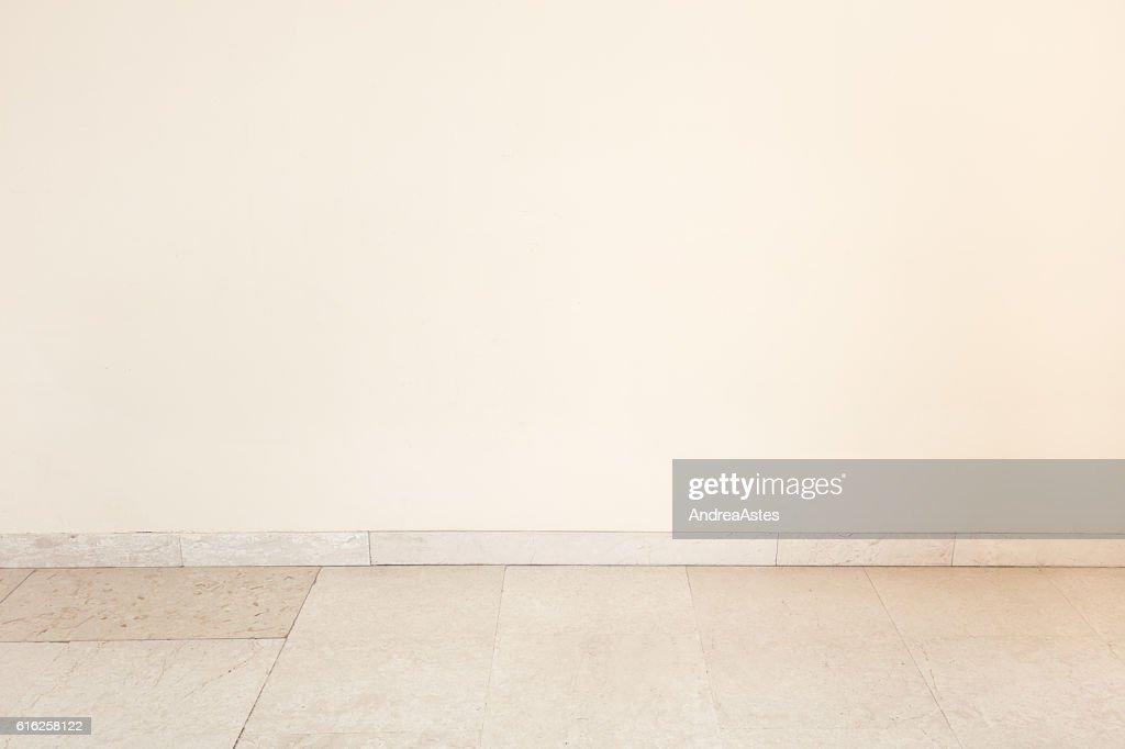Marble floor in empty room with blank wall : Foto de stock