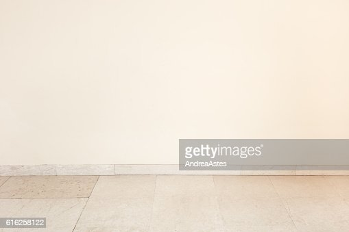 Marble floor in empty room with blank wall : Foto de stock