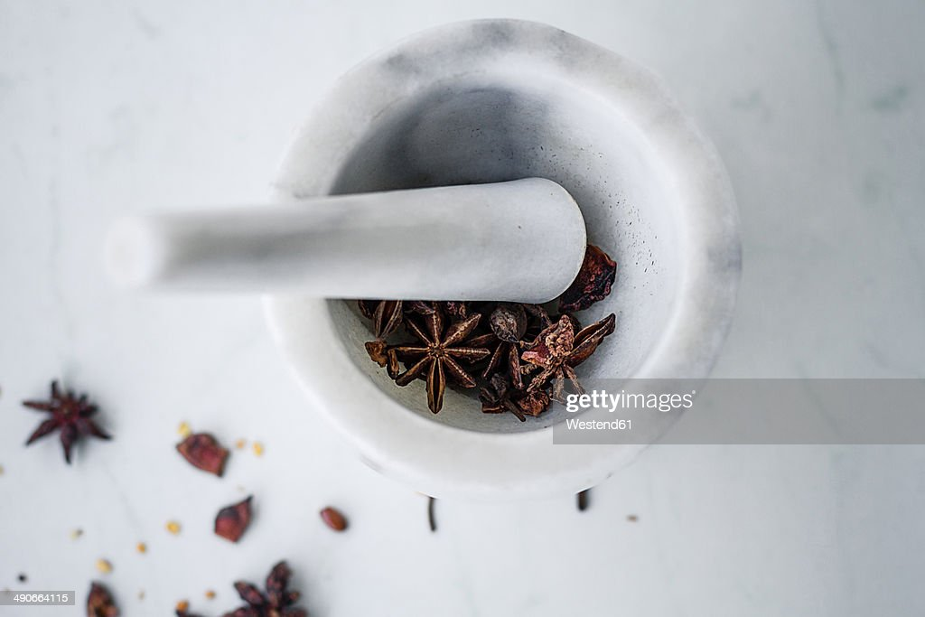 Marble mortar and pestle with star anise (Illicium verum)