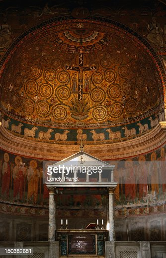 Marble pulpit and mosaics in the 12th century apse at Basilica di San Clemente.