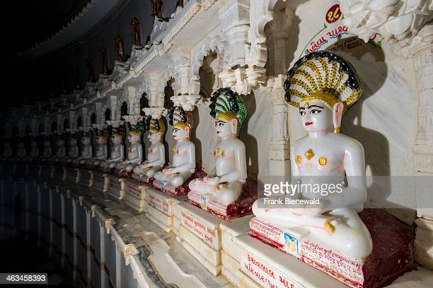 Marble statues of Jain prophets inside the Temple of 108 Jains situated at the foot of at Shatrunjaya hill one of the major pilgrim sites for Jains