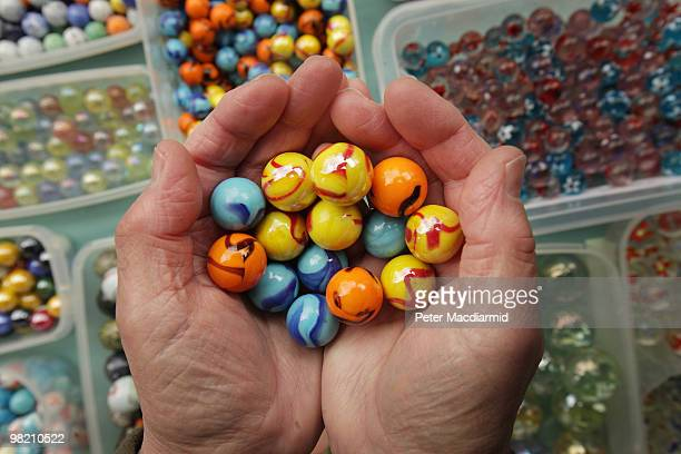 Marbles are displayed for sale at the British and World Marbles Championship on April 2 2010 in Tinsley Green England The game is played between two...