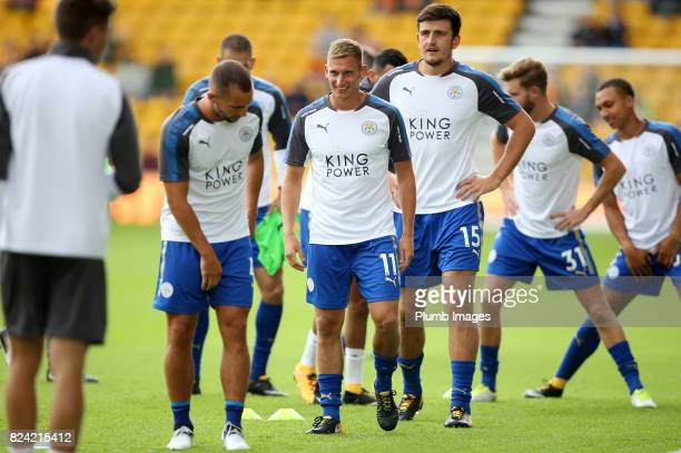 Marc Albrighton and Harry Maguire of Leicester City warm up at Molineux Stadium ahead of the pre season friendly between Wolverhampton Wanderers and...