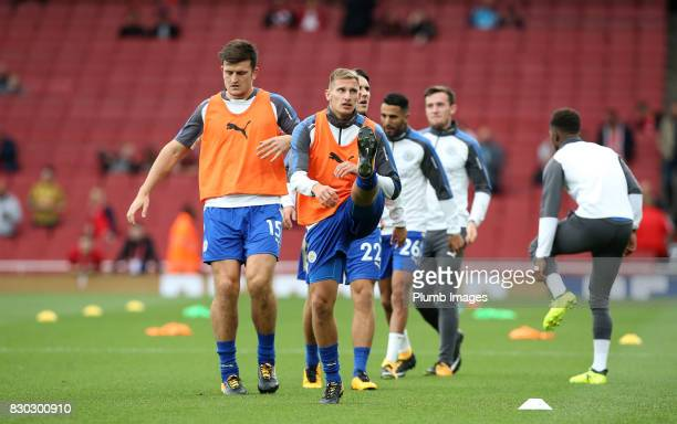 Marc Albrighton and Harry Maguire of Leicester City warm up at Emirates Stadium ahead of the Premier League match between Arsenal and Leicester City...