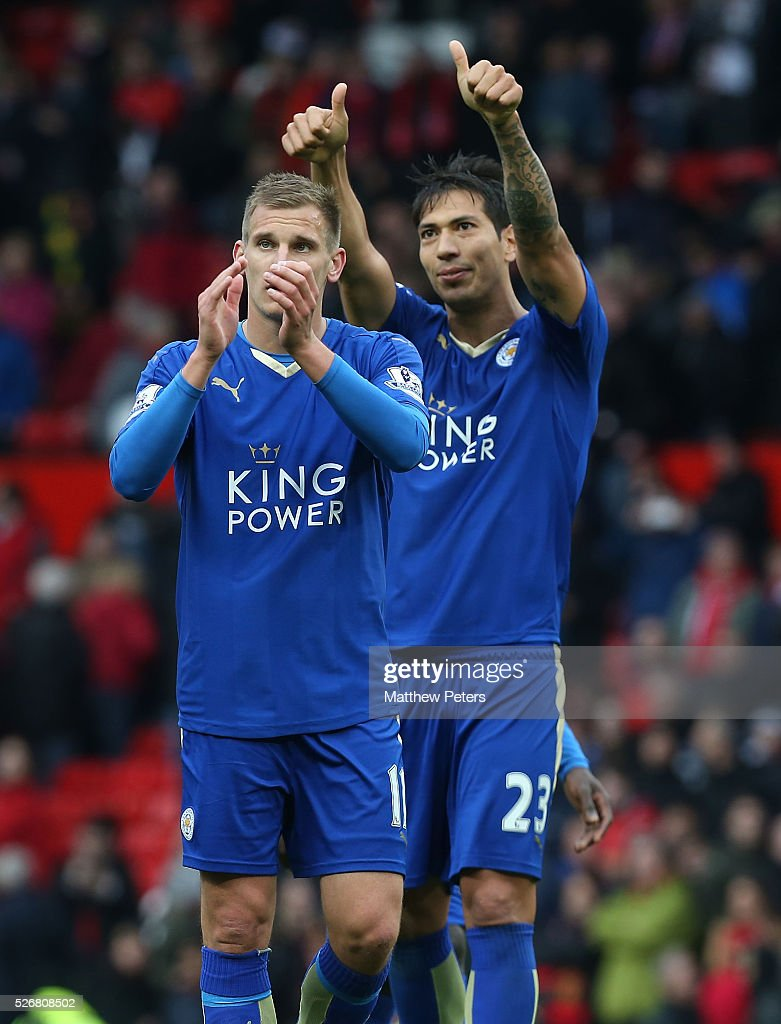 <a gi-track='captionPersonalityLinkClicked' href=/galleries/search?phrase=Marc+Albrighton+-+Winger&family=editorial&specificpeople=5734412 ng-click='$event.stopPropagation()'>Marc Albrighton</a> and <a gi-track='captionPersonalityLinkClicked' href=/galleries/search?phrase=Leonardo+Ulloa&family=editorial&specificpeople=7433674 ng-click='$event.stopPropagation()'>Leonardo Ulloa</a> of Leicester City applaud the away fans after the Barclays Premier League match between Manchester United and Leicester City at Old Trafford on May 1, 2016 in Manchester, England.